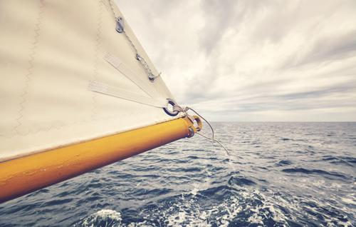 Close up picture of old schooner sail tip. Sky Vacation & Travel Ocean Clouds Far-off places Freedom Watercraft Horizon Retro Weather Adventure Wind Navigation