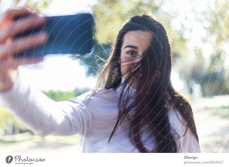 Beautiful young woman selfie in the park Lifestyle Joy Happy Face Telephone PDA Camera Technology Human being Feminine Young woman Youth (Young adults) Woman
