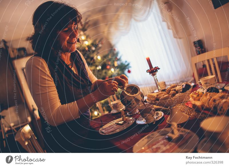 Human being Woman Christmas & Advent Adults Warmth Life Feminine Religion and faith Moody Together Flat (apartment) Living or residing 45 - 60 years Decoration
