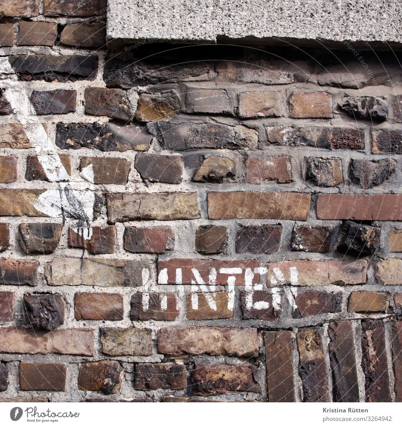 Town Wall (building) Wall (barrier) Facade Characters Communicate Signs and labeling Protection Safety Direction Arrow Brick War Clue Behind