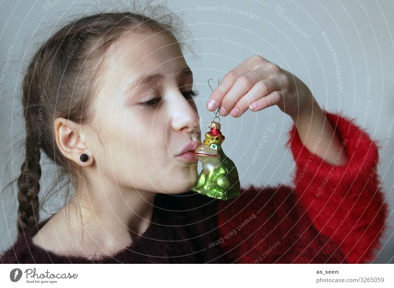 Kiss me ... Girl Infancy Face 8 - 13 years Child Youth culture Sign Frog Prince To hold on Kissing Esthetic Fantastic Friendliness Glittering Cute Green Red