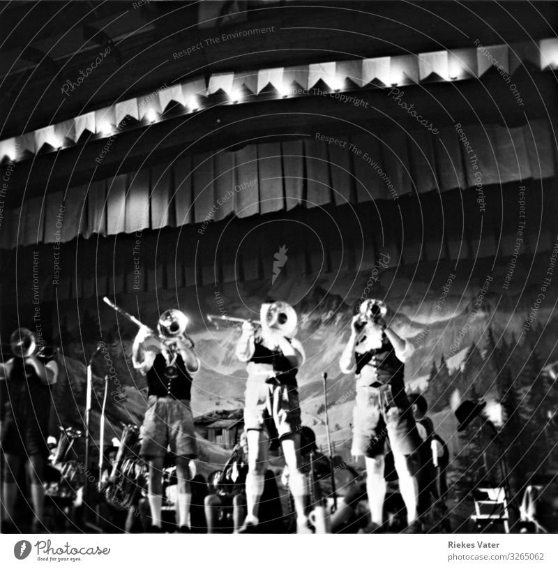 chapel Night life Music Feasts & Celebrations Concert Stage Band Orchestra Work and employment Trumpet Leather shorts Costume 1950s Folklore music Interior shot