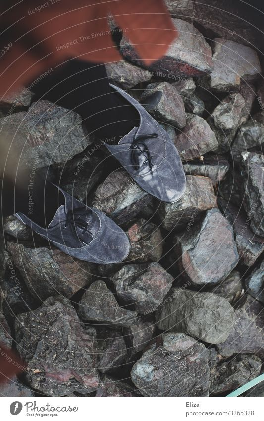 stand on stones Feminine Footwear Gray Stone Stand Barrier Uneven Colour photo Subdued colour Exterior shot Day Bird's-eye view
