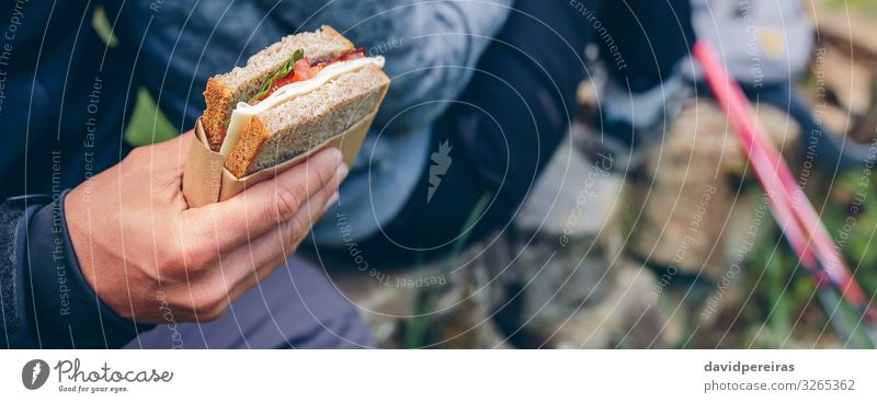 Sandwich that a couple is going to eat doing trekking Eating Lifestyle Leisure and hobbies Vacation & Travel Adventure Mountain Hiking Sports Climbing