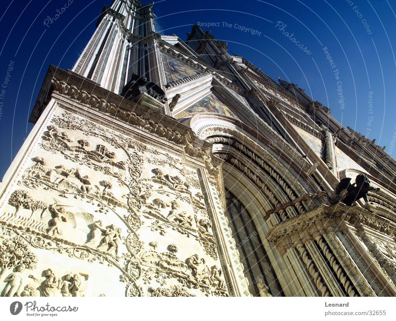 façade Facade Sculpture Mosaic Capital of a pillar Relief Religion and faith Bible Europe Italy House of worship front Cathedral Column Arch Sky
