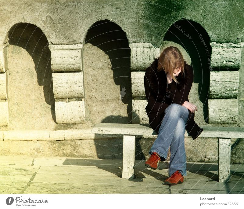 concentration Woman Human being Sun Wall (building) Laughter Shadow Bench Concentrate Stone arcade Arch