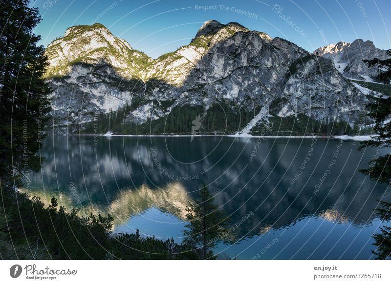blue Vacation & Travel Nature Landscape Cloudless sky Sunrise Sunset Beautiful weather Rock Alps Mountain Dolomites Lake Pragser Wildsee Lake Italy South Tyrol