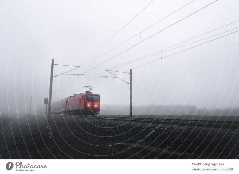Red train locomotive through mist moving on railway tracks Vacation & Travel Trip Winter Autumn Bad weather Fog Transport Public transit Railroad Engines