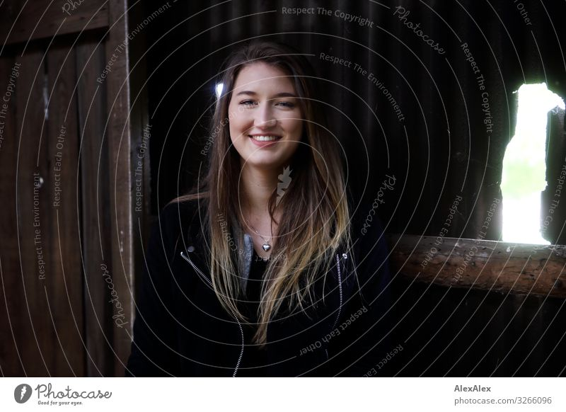 Portrait of a young woman at a barn Style Joy Beautiful Life Well-being Barn door Young woman Youth (Young adults) 18 - 30 years Adults Landscape Jacket