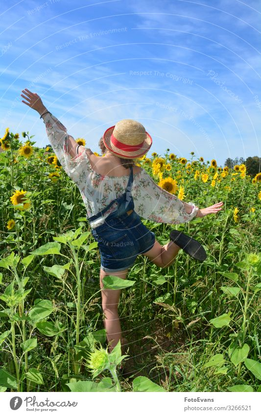 Girl from behind, jumping up and down in a field of sunflowers Joy Happy Athletic Trip Summer Human being Feminine Young woman Youth (Young adults) 1