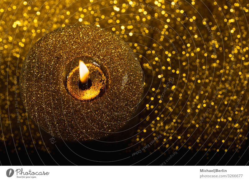 Golden candle from above Christmas & Advent Fire Flame Candle Illuminate Glittering Above Side Copy Space Colour photo Close-up Macro (Extreme close-up) Blur