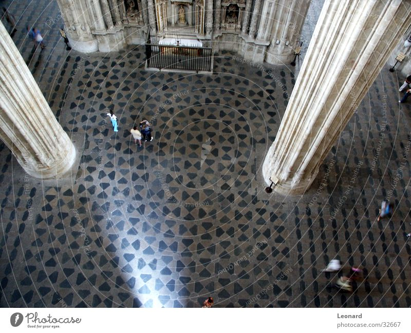 in the cathedral Building Gothic period Human being Light Mosaic Floor covering Fence Religion and faith Spain House of worship Cathedral Perspective Column