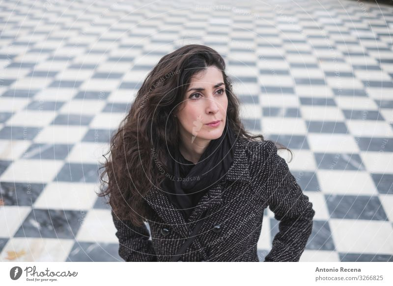 Mid adult woman looking at camera in park in serene portrait Chess Human being Woman Adults Brunette Esthetic Perturbed tiled floor Chessboard background pretty