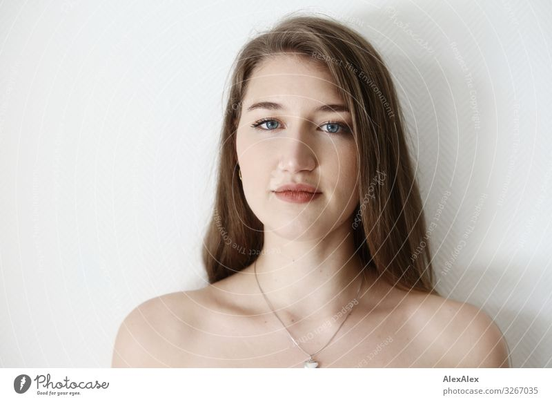 Portrait of a young woman in front of a white wall Elegant Style Joy Beautiful Wellness Life Young woman Youth (Young adults) Face 18 - 30 years Adults