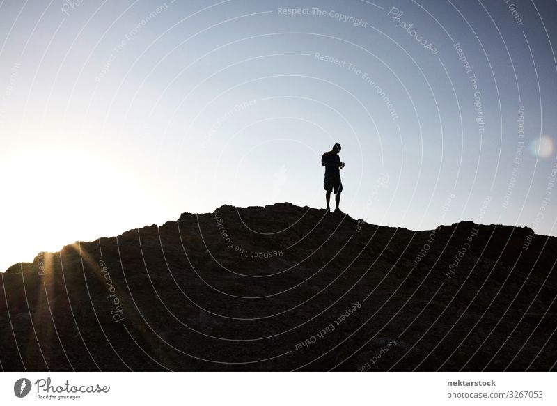 Silhouette of Man Atop a Hill in Atacama Sunrise Adults Nature Sky Beautiful weather Rock Discover Walking Hiking Andes Mountains panorama 1 Person Chile
