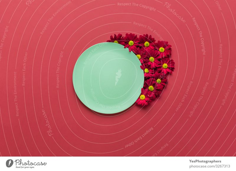Green empty dish and red flowers. Eco-friendly platter. Plate Healthy Eating Kitchen Restaurant Flower Ornament Hip & trendy Red above view backdrop
