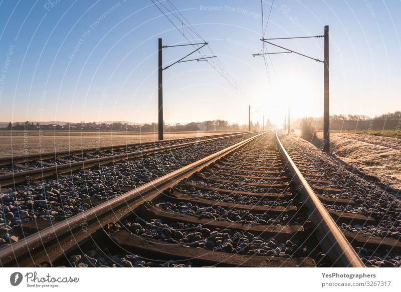 Railroad tracks and frosty landscape. Rail tracks at sunrise Vacation & Travel Trip Freedom Winter Nature Landscape Beautiful weather Transport