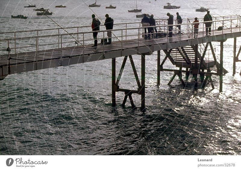 pier Jetty Watercraft Ocean Human being Fishing rod Group quay Harbour Stairs Stride
