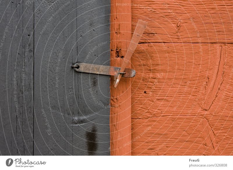 lengthwise and crosswise Hut Door Locking bar Wood Metal Gray Orange Texture of wood Branch Contrast Closed wood split pin Colour photo Exterior shot Day