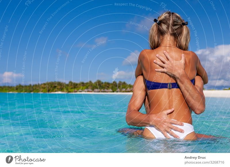 happy cute boy and girl enjoy swim on beach. Vacation & Travel Tourism Summer Summer vacation Beach Ocean Island Human being Masculine Feminine Young woman