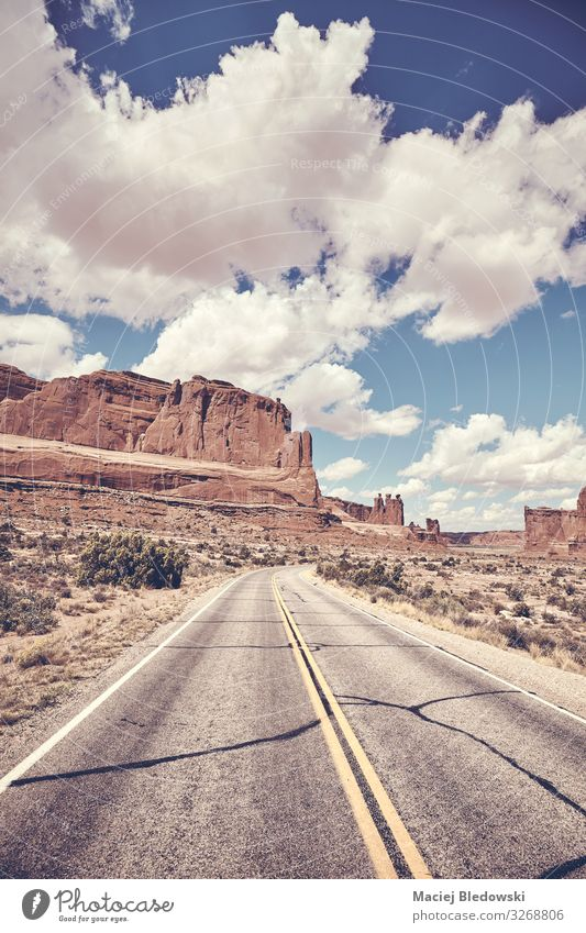 Scenic road in Arches National Park, USA. Vacation & Travel Tourism Trip Adventure Freedom Nature Landscape Sky Rock Canyon Street Highway Retro Utah America