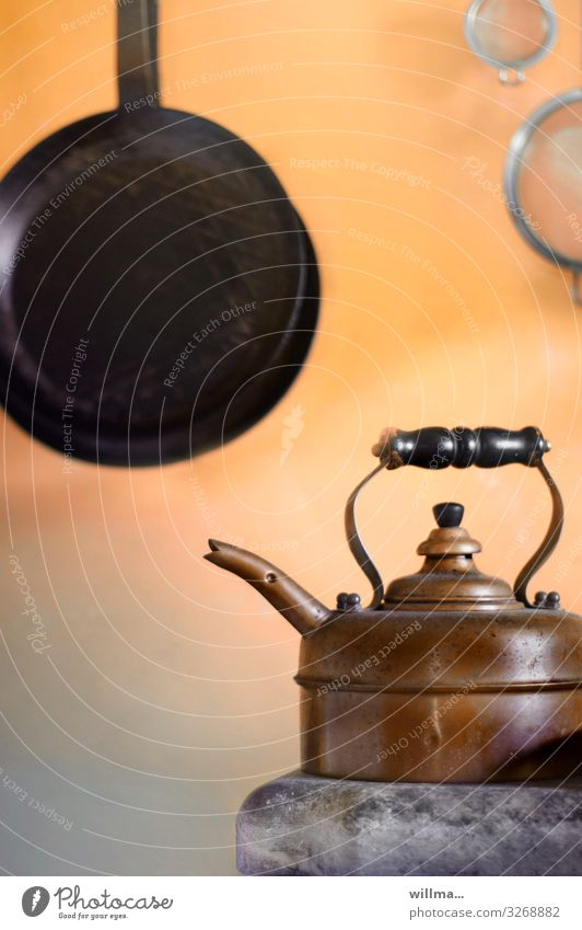 Nostalgic old teakettle and frying pan Living or residing Kitchen Teapot Kettle Pan Sieve Brass Copper Hot Historic Nostalgia Ancient Cozy Interior shot