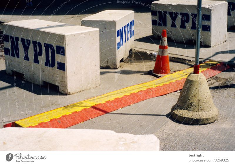 construction site Traffic infrastructure Gray Barrier Warn Hat Construction site Police Force Colour photo Exterior shot Light Shadow Contrast