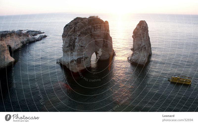 Water Sun Ocean Coast Watercraft Rock Cliff Rock arch Passage Boating trip Beirut