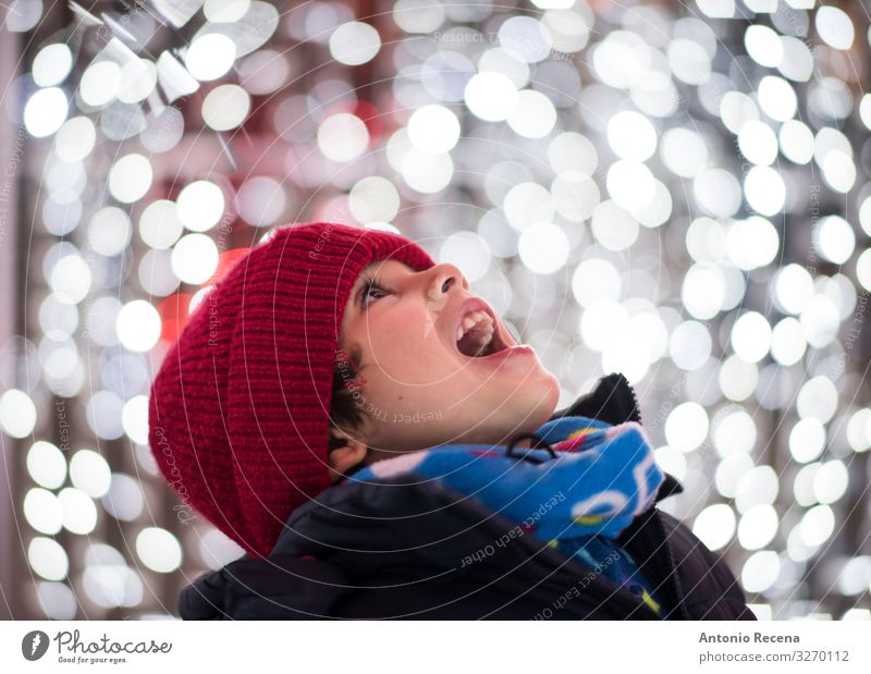 boy head shot portrait looking christmas lights Joy Winter Feasts & Celebrations Child Human being Boy (child) Scarf Hat Smiling White Emotions Enthusiasm