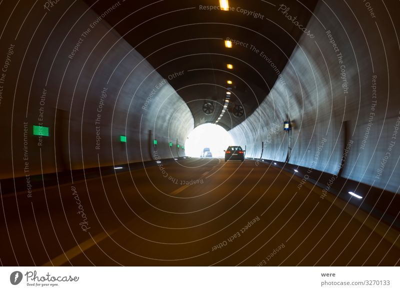 Exit of a motorway tunnel Tunnel Traffic infrastructure Driving Vacation & Travel Dark exit freeway road car drive freeway ride light at the end of the tunnel