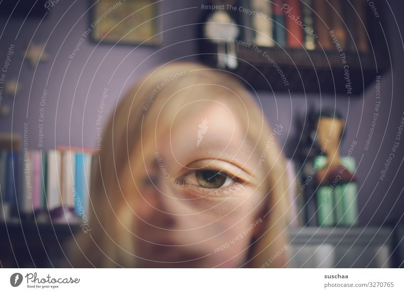 eye of a face distorted with a magnifying glass | see better Eyes One-eyed Whimsical Distorted Illusion Enlarged Magnifying glass Joke Absurdity Joy Funny