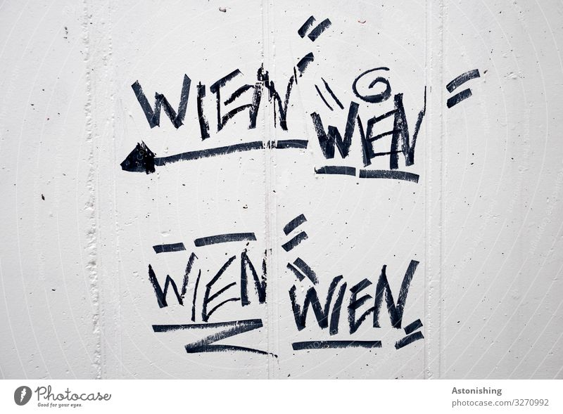 Town White Black Graffiti Wall (building) Wall (barrier) Facade Gray Wild Line Characters Concrete Sign Digits and numbers Write Direction