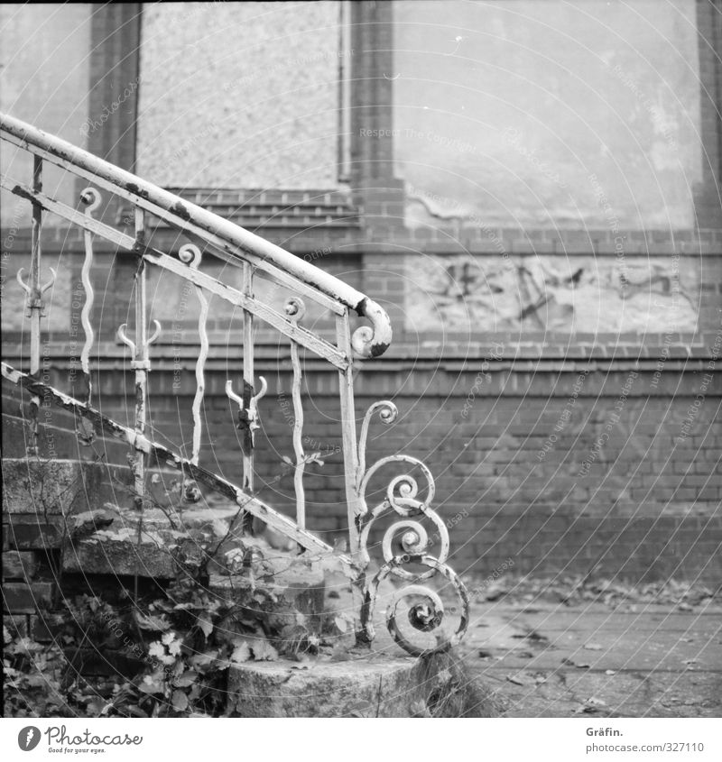 forgotten places Building Stairs Facade Metal Old Historic Broken Gray Black White Loneliness Nostalgia Decline Transience Black & white photo Exterior shot