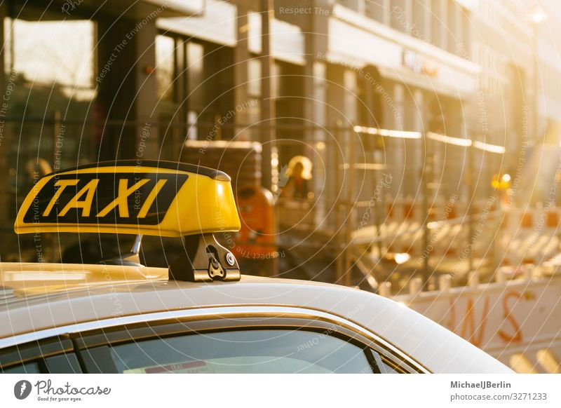 Taxi sign on the roof of a car, city motif with construction site Life Means of transport Public transit Motoring Yellow Berlin Germany City Signs and labeling