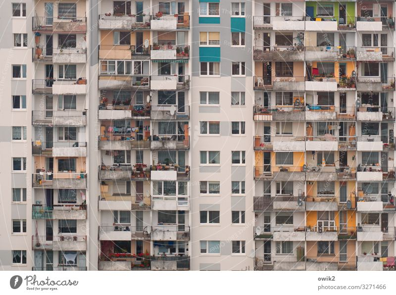 affluent society Living or residing Flat (apartment) Poland Town High-rise Building Wall (barrier) Wall (building) Facade Balcony Window Concrete Glass Metal