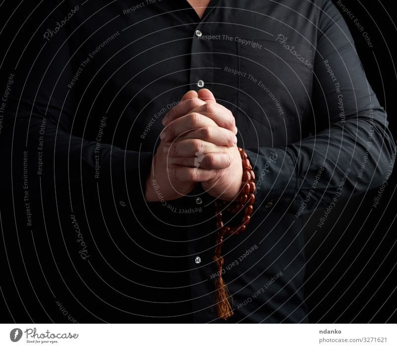 man in a black shirt joined his hands Lifestyle Harmonious Relaxation Meditation Yoga Human being Man Adults Hand Fingers Love Black Goodness Hope Peace Belief