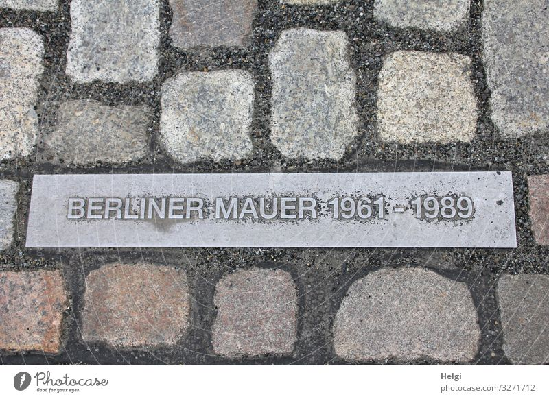Memorial Berlin Wall on metal plate between cobblestones Capital city Paving stone The Wall Monument Stone Metal Sign Characters Historic Uniqueness Brown Gray