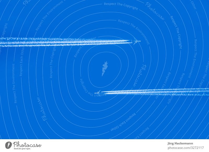 sky with condensation trail of two aircrafts passing each other Harmonious Vacation & Travel Sky Horizon Transport Aircraft Soft Blue Cold Jet acars background