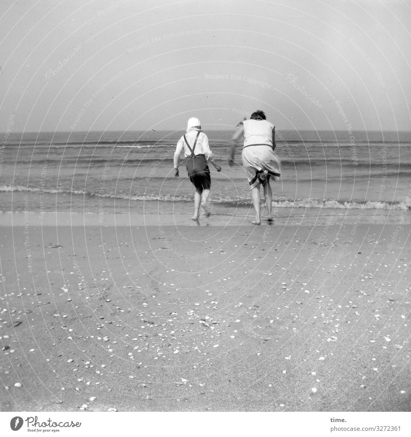 Stiff breeze Ocean windy Summer seashells Waves vacation Life Walking in common at the same time Horizon Sand Beach Coast holidays Analog B/W black-and-white
