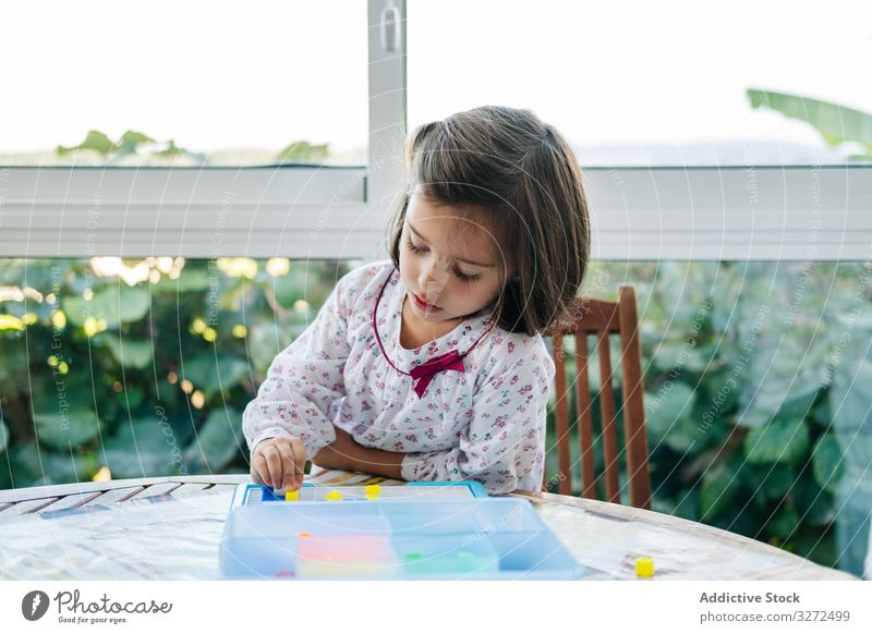 Girl playing with mosaic board game girl creative focused concentration piece colorful concentrate education puzzle assemble fun child childhood kid little