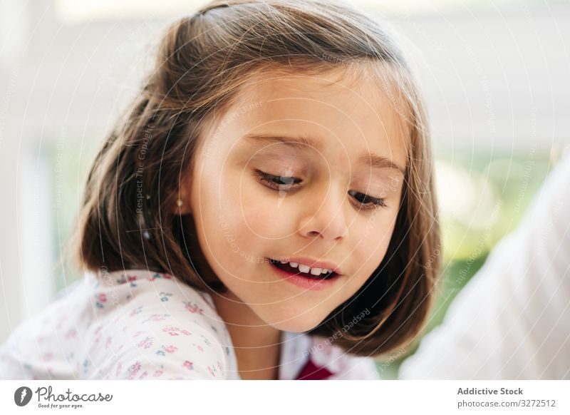 Cute little girl playing game smile involved participation fun happy child childhood kid cute adorable dark hair joyful cheerful sit creative learn interesting