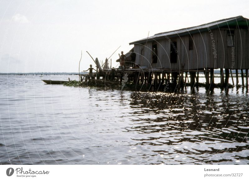 pile dwelling House (Residential Structure) Africa Lake Watercraft Human being Historic boat benin