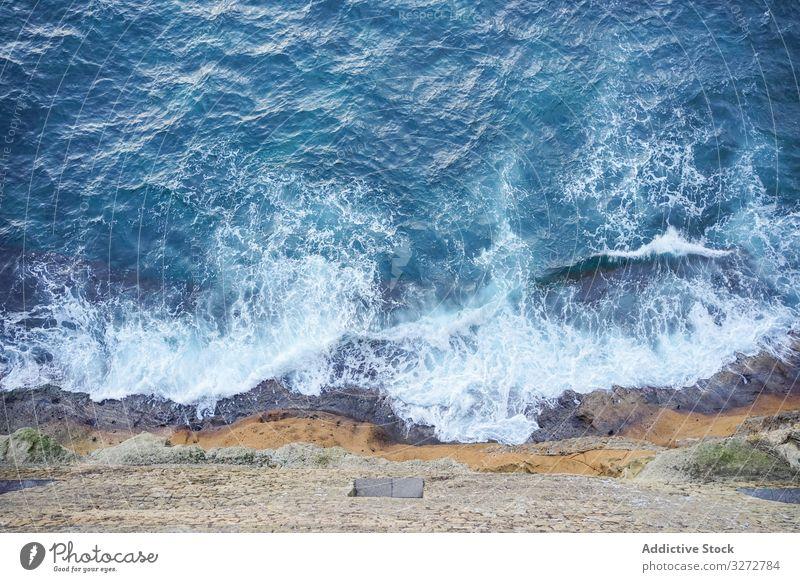 Beautiful blue sea under big mountain seascape water coast shore turquoise wave foam peak peace rock beautiful travel summer ocean nature scenery view bay
