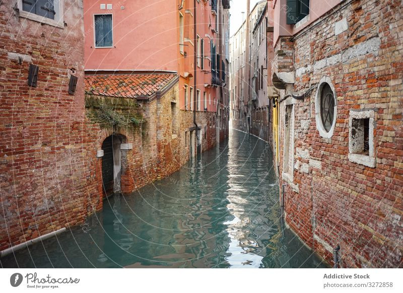 Waterway and ancient buildings at city street water canal old architecture brick historical colorful landmark travel view town empty tourism famous venice italy