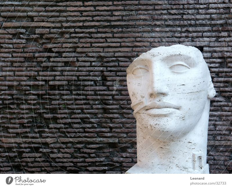 Human being Man Face Stone Wall (barrier) Building Art Statue Craft (trade) Historic Sculpture Rome Exhibition Death's head