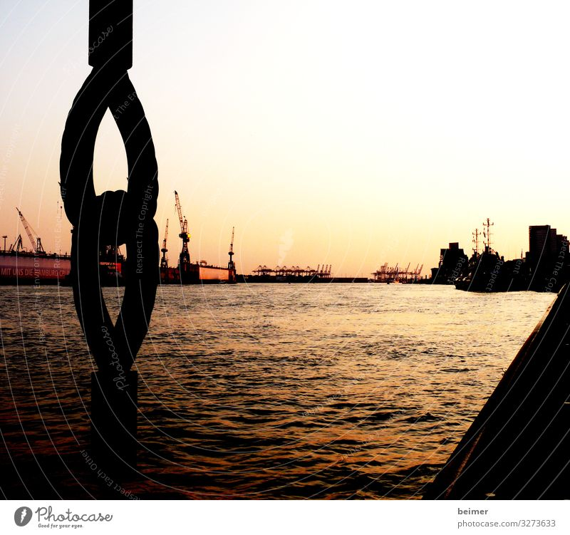 My pearl Water Cloudless sky Sunrise Sunset Port of Hamburg Port City Deserted Harbour Tourist Attraction Steel Kitsch Gold Orange Black Moody Warm-heartedness