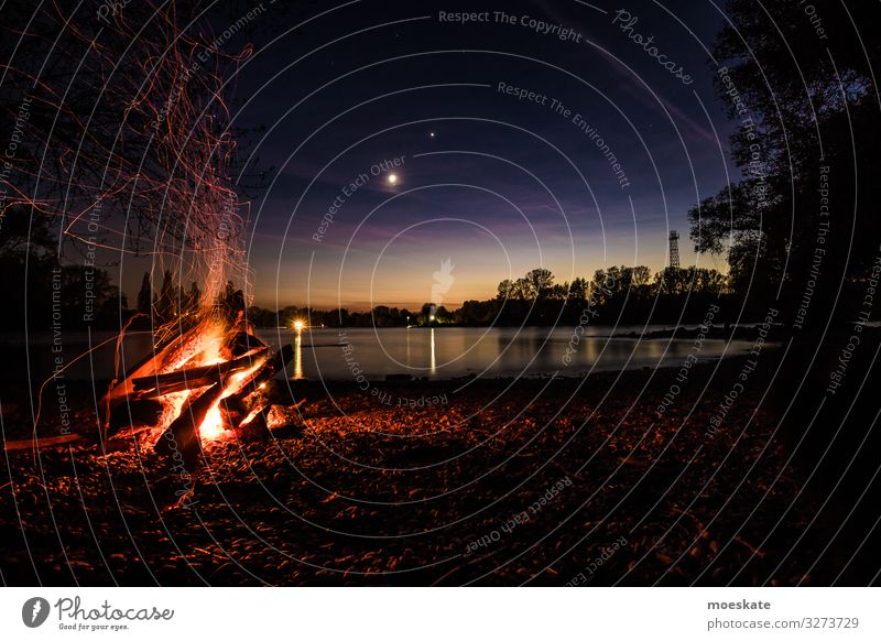Bonfire in a summer night at the river 2 Fire Coast Lakeside River bank Hot Sunset Camp fire atmosphere Fireplace Nature Colour photo Subdued colour Deserted