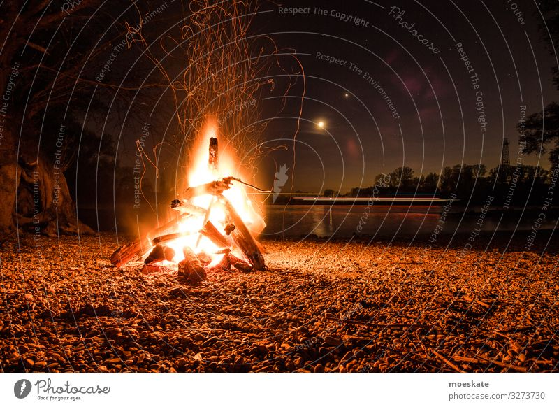 Bonfire on a summer night by the river Spring Summer Coast Lakeside River bank Beach Hot Fireplace Camp fire atmosphere Nature Night Summer night Colour photo