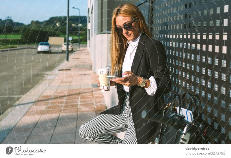 Businesswoman using mobile and drinking coffee with her scooter Woman Human being Beautiful Street Lifestyle Adults Style Copy Space Fashion Leisure and hobbies