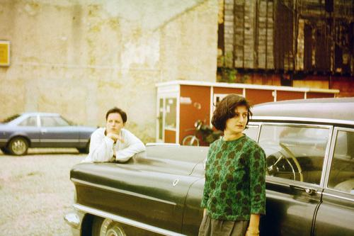 alt l two bored, aimless, young women on a road trip in an old car. Road movie of two friends, together on road trip with black nostalgic oldtimer. Best friends, drop-outs on a film trip, escape, journey into the unknown.